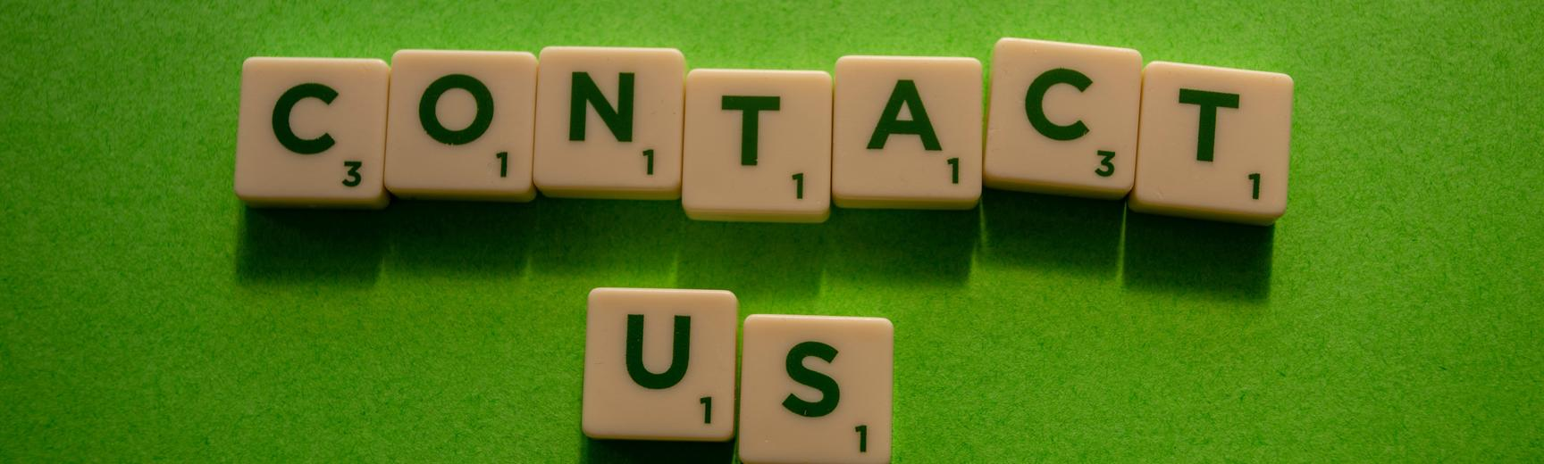 Scrabble pieces spelling contact us